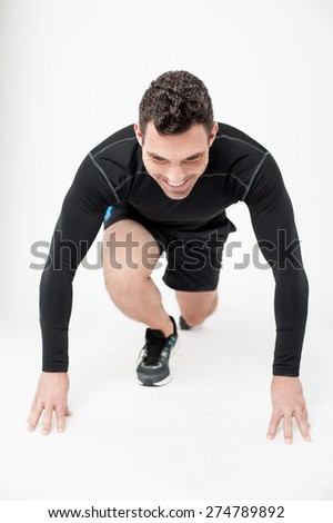 Competitive male athlete in starting position