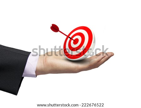 competitive marketing concept: render of bullseye with dart over a businessman hand isolated on white background - stock photo