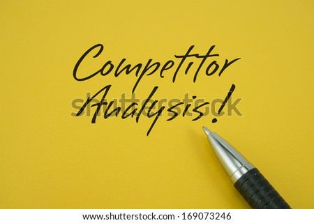 Competitor Analysis note with pen on yellow background
