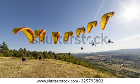 Compilation a paragliding takeoff - stock photo
