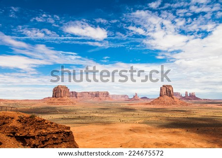 Complementary colours blue and orange in this iconic view of Monument Valley, USA - stock photo