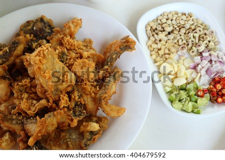 Complementing fish recipe - deep fried fish served with spices side dishes, vegetable and special sauce. - stock photo