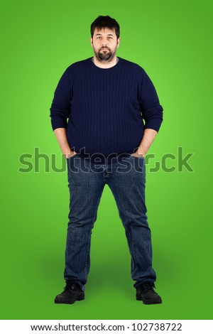 Complete body shot of a big guy looking at camera, real ordinary middle age bearded white man with weight problem in front of green screen, can be actor or extra. - stock photo