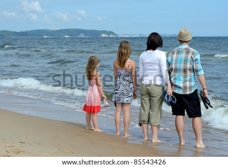 Complete family enjoying sea landscape