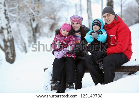 complete family with children walking in winter - stock photo