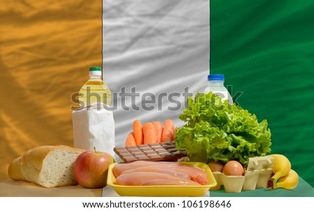 complete national flag of croatia covers whole frame, waved, crunched and very natural looking. In front plan are fundamental food ingredients for consumers, symbolizing consumerism - stock photo