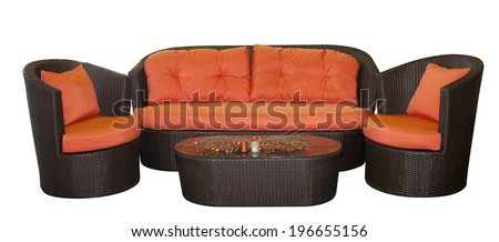 Complete set of rattan furniture with orange pillows isolated on white background and clipping path - stock photo