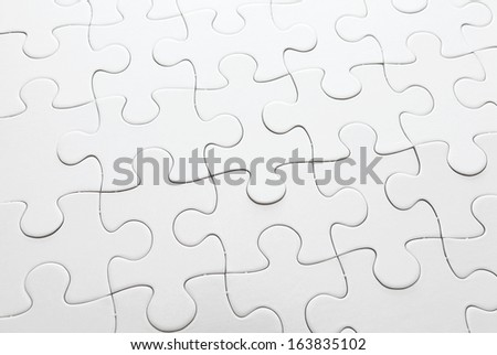 Complete white puzzle - stock photo