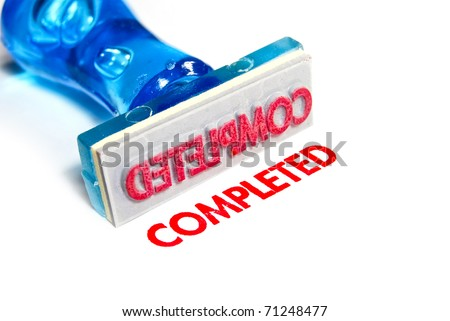 completed letter on blue rubber stamp isolated on white background - stock photo