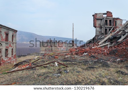 Completely destroyed a two-story brick building - stock photo