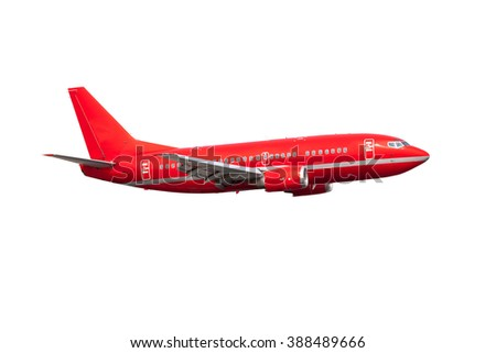 Completely red passenger plane. A side view of aircraft without gear. - stock photo