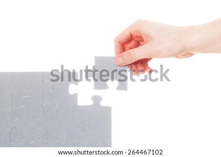 Completing the last piece of jigsaw puzzle. Isoalted on white. Search for the solution, solving the problem, answer, business connection concept. - stock photo