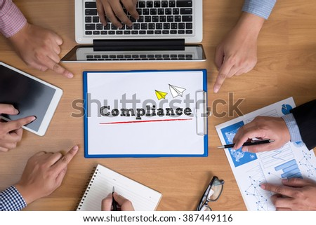 Compliance Concept, Business team hands at work with financial reports and a laptop, top view - stock photo