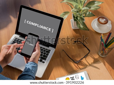 Compliance Concept Freelance desktop with accessories and distance work tools, blank screen laptop computer and phone, sunglasses, coffee - stock photo