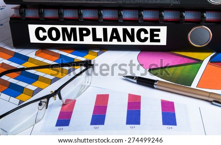 compliance concept on document folder - stock photo