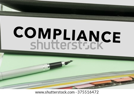 Compliance - Ring Binder in the office. Management file. Business Concept - stock photo