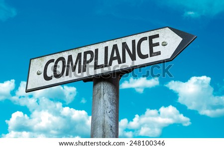 Compliance sign with sky background - stock photo