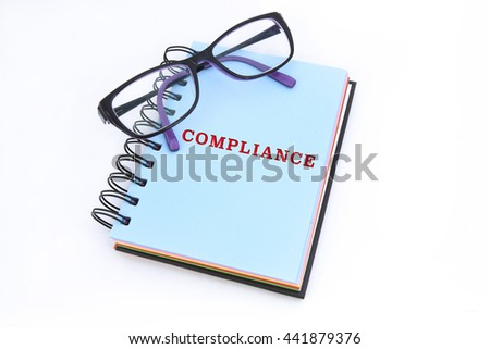 COMPLIANCE word in notepad with white background - stock photo