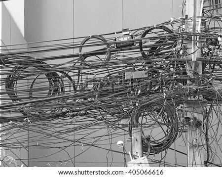 complicated arrangement of Bangkok electric wire - stock photo