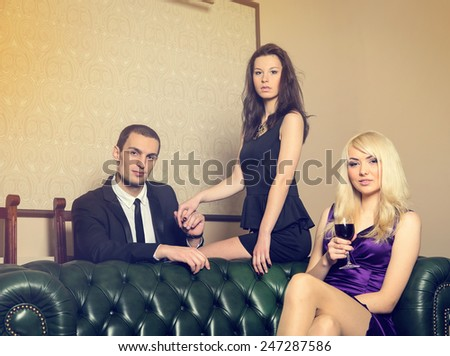 Complicated love relationship between three people. At party at the club. One man and two women - love triangle. She saw her man with another woman and jealous. Cheating husband cheating on his wife. - stock photo