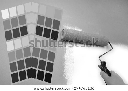 complimentary grey color chart and hand painting wall - stock photo