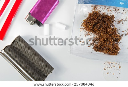 Components and tools for making homemade cigarettes . - stock photo