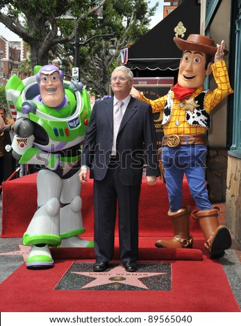Composer Randy Newman with Toy Story 3 stars Buzz Lightyear and Woody was honored today with a star on the Hollywood Walk of Fame. June 2, 2010  Los Angeles, CA Picture: Paul Smith / Featureflash - stock photo