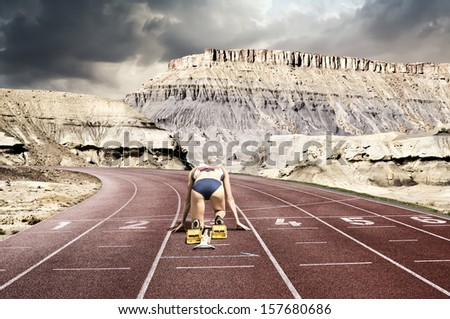 Composing of a race track with female starter set  into a  california mountains street - stock photo