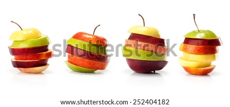 composite from different varieties of apples cut into slices isolated on white background  - stock photo