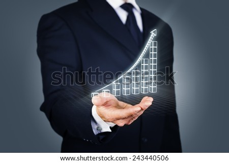 Composite image of a businessman with a rising chart in wireframe mode - stock photo