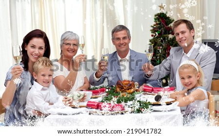 Composite image of a Family tusting in a Christmas dinner with white wine against snow