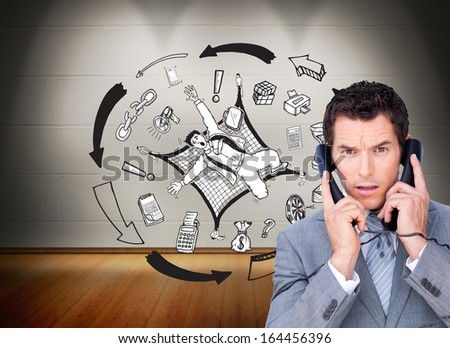Composite image of anxious businessman tangle up in phone wires isolated - stock photo