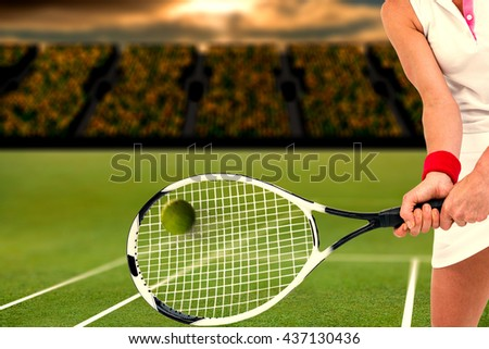Composite image of athlete is playing tennis in a stadium