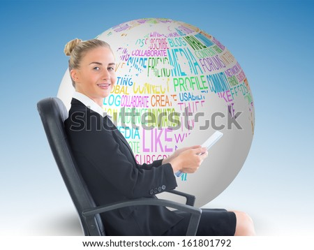 Composite image of attractive blonde businesswoman sitting in swivel chair holding folder - stock photo