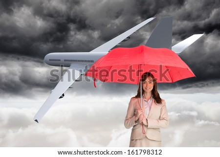 Composite image of attractive businesswoman holding red umbrella against white background