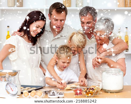 Composite image of Brother and sister baking in the kitchen with snow falling - stock photo