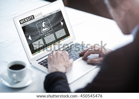 Composite image of build website interface against businessman using his laptop at restaurant