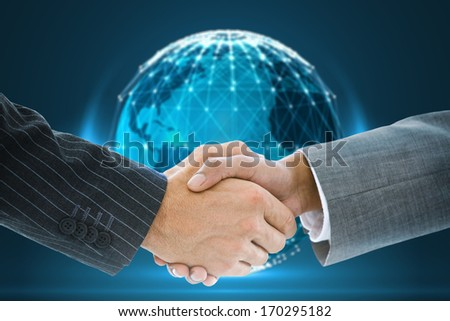 Composite image of business handshake against glowing sphere on black background - stock photo