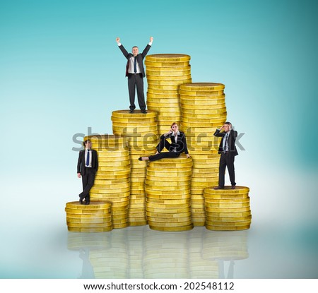 Composite image of business people on pile of coins against blue vignette - stock photo