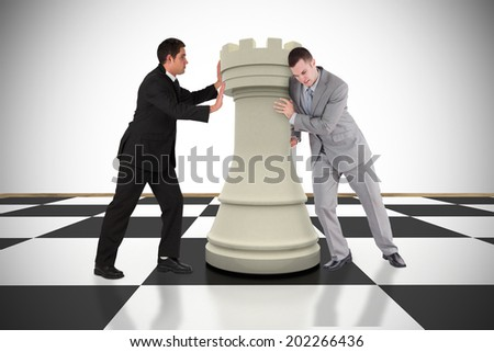Composite image of business people pushing chess piece against white background with vignette - stock photo