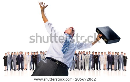 Composite image of businessman holding briefcase and cheering against row of business people - stock photo