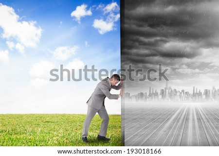 Composite image of businessman pushing away scene of cityscape on the horizon