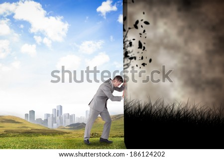 Composite image of businessman pushing away scene of dark gothic scene with trees - stock photo