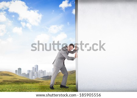 Composite image of businessman pushing away scene of grey room