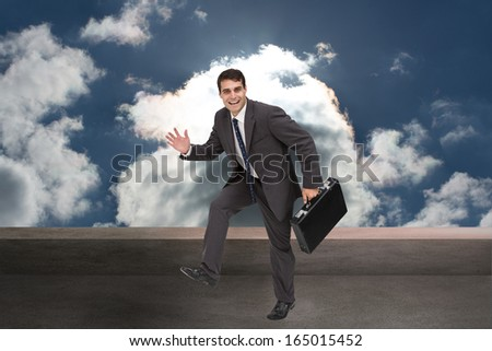 Composite image of cheerful attractive businessman in a hury