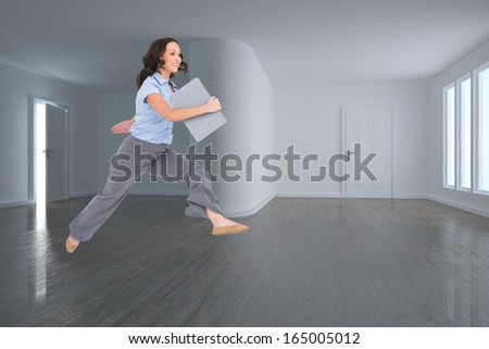 Composite image of cheerful classy businesswoman jumping while holding clipboard - stock photo