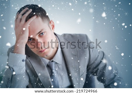 Composite image of close up of businessman who got bad news against snow falling - stock photo