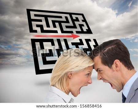 Composite image of colleagues quarreling head against head in front of holographic maze in the sky - stock photo