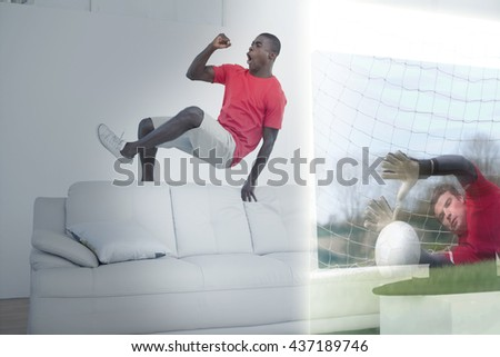 Composite image of excited man is watching sport match on television at home