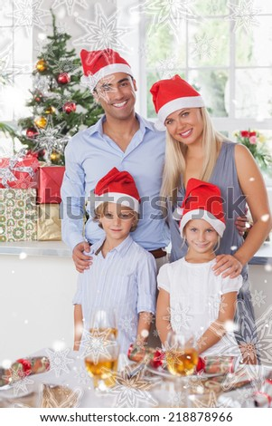 Composite image of family christmas portrait against snowflakes - stock photo